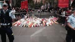 Miles de flores para víctimas del secuestro en Sydney